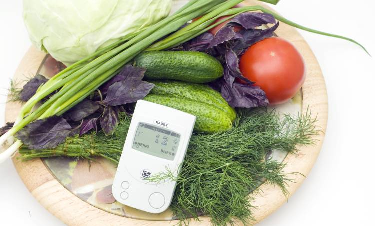 radioactivity meter next to vegetables