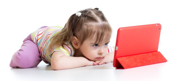 child focused on tablet